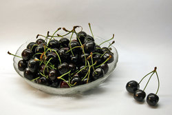 bowl full of black cherries