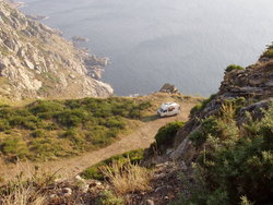 VW bus camping on coastline